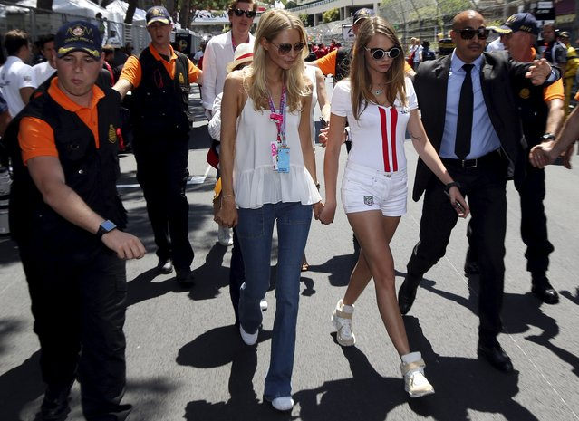 British model Cara Delevingne (2nd R) arrives at the starting grid before the Monaco F1 Grand Prix May 24, 2015. (Photo by Stefano Rellandini/Reuters)