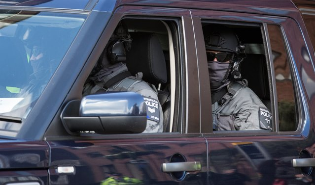 Police travel in a car as part of security as President Obama's motorcade leaves following a visit at the Globe theatre on the 400th anniversary of William Shakespeare's death at The Globe Theatre on April 23, 2016 in London, England. (Photo by Matt Cardy/Getty Images)