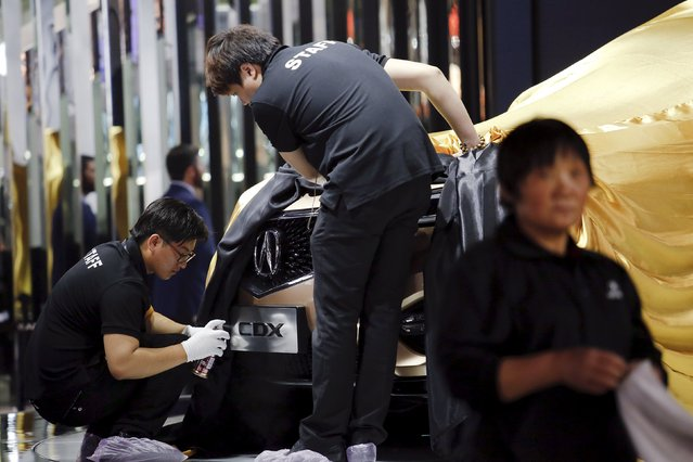 Members of staff prepare the Acura CDX SUV to be presented during the Auto China 2016 auto show in Beijing April 25, 2016. (Photo by Damir Sagolj/Reuters)