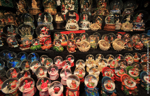 Stock is displayed as Christmas shoppers browse the offerings at the Bath Christmas Market on its opening night on November 24, 2011 in Bath, England
