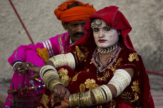 A Pakistani couple from the Bheel nomad community attend a folk heritage festival in Islamabad, Pakistan, Monday, April 14, 2014. The festival was organized to emphasize the importance of dying folk culture in Pakistan. (Photo by B. K. Bangash/AP Photo)