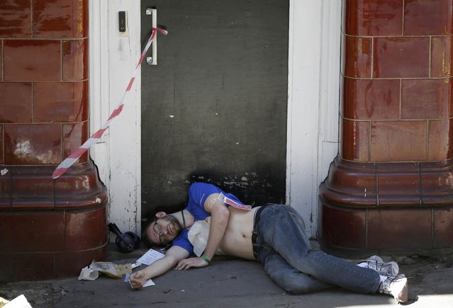 An actor lies on the ground during Exercise Strong Tower at the scene of a mock terror attack at a disused underground station in central London, Britain June 30, 2015. (Photo by Peter Nicholls/Reuters)