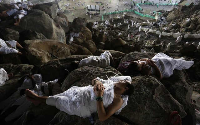 Muslim pilgrims rests on Mount Arafat as they take part in one of the Hajj rituals in Saudi Arabia on August 10, 2019. Arafat is the site where Muslims believe the Prophet Mohammed gave his last sermon about 14 centuries ago after leading his followers on the pilgrimage. The ultra-conservative kingdom, which is undergoing dramatic social and economic reforms, has mobilised vast resources for the six-day journey, one of the five pillars of Islam. (Photo by APA Images/Shutterstock)
