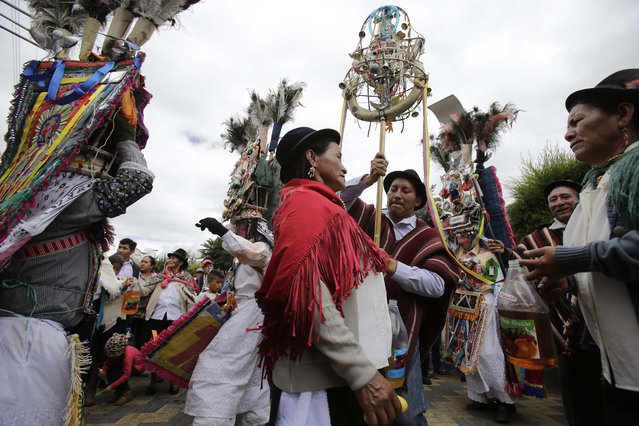 In this June 7, 2015 photo, the steward or prioste, accompanied by his family, leads the way for the dancers during the Corpus Christi celebrations Danzante de Pujili, in Pujili, Ecuador. (Photo by Dolores Ochoa/AP Photo)