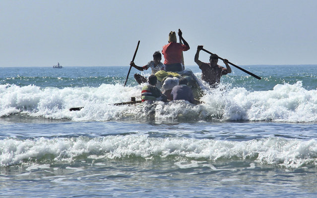 In this January 16, 2017, photo, Rohingya fishermen launch a raft made of empty plastic containers to go fishing into the rough sea off of  Tha Pyay Taw village, Maungdaw, western Rakhine state, Myanmar. (Photo by Esther Htusan/AP Photo)