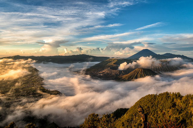 """Mount Bromo Sunrise"". The morning sun illuminates the fog filled caldera with the steaming Mount Bromo volcano in the Bromo Tengger Semeru National Park. Photo location: Bromo Tengger Semeru National Park, East Java, Indonesia. (Photo and caption by Dale Johnson/National Geographic Photo Contest)"