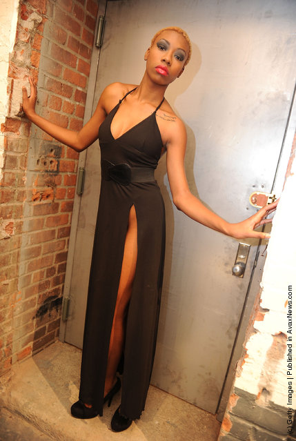 A model poses backstage at the White Carpet Blaque Runway fashion fundraiser at the Causey Contemporary Art Gallery in New York City