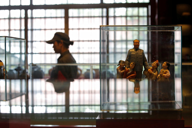 A staff member walks past a porcelain figure of late Chinese chairman Mao Zedong at Jianchuan Museum Cluster in Anren, Sichuan Province, China, May 13, 2016. (Photo by Kim Kyung-Hoon/Reuters)