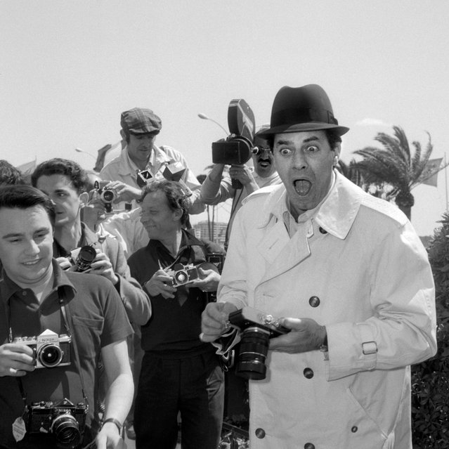 Comedian, director and singer Jerry Lewis jokes with photographers, May 4, 1967, at his arrival at the International Cannes Film Festival in Cannes, France. (Photo by STF/AFP Photo/Getty Images)