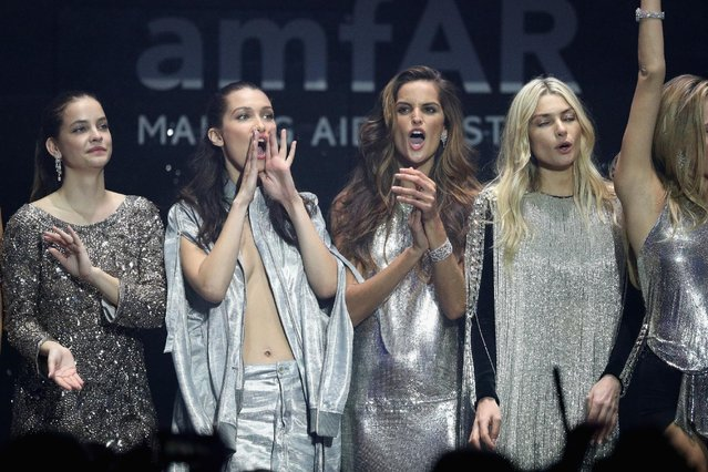 (L-R) Barbara Palvin, Bella Hadid, Izabel Goulart and Jessica Hart appear on stage at the amfAR's 23rd Cinema Against AIDS Gala at Hotel du Cap-Eden-Roc on May 19, 2016 in Cap d'Antibes, France. (Photo by Andreas Rentz/Getty Images)