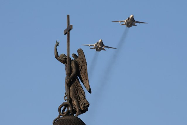 Sukhoi Su-24 M bombers fly over St Petersburg' s Palace Square during a rehearsal of a Victory Day military parade marking the 72 nd anniversary of the victory over Nazi Germany in the 1941-1945 Great Patriotic War, the Eastern Front of World War II. (Photo by Peter Kovalev/TASS)