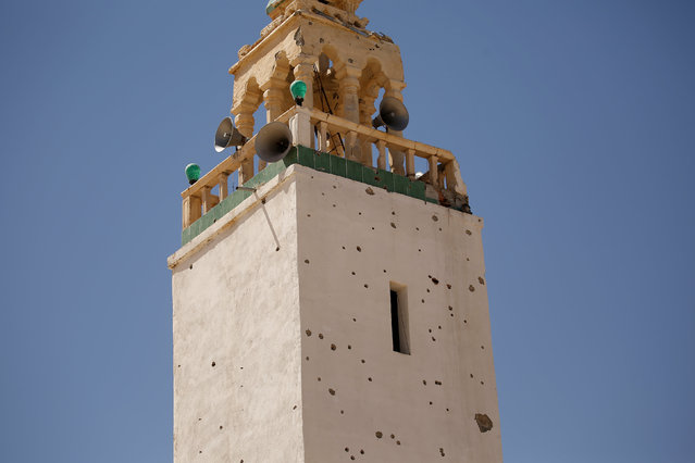A minaret, that was damaged during fighting between Islamic State jihadists and government forces, is seen in Ben Guerdane, near the Libyan border, Tunisia April 10, 2016. After a U.S. air strike killed a Tunisian jihadist commander in western Libya in late February, dozens of Islamic State fighters sneaked across the border into Tunisia and attacked an army barracks and police bases in the town of Ben Guerdane. (Photo by Zohra Bensemra/Reuters)