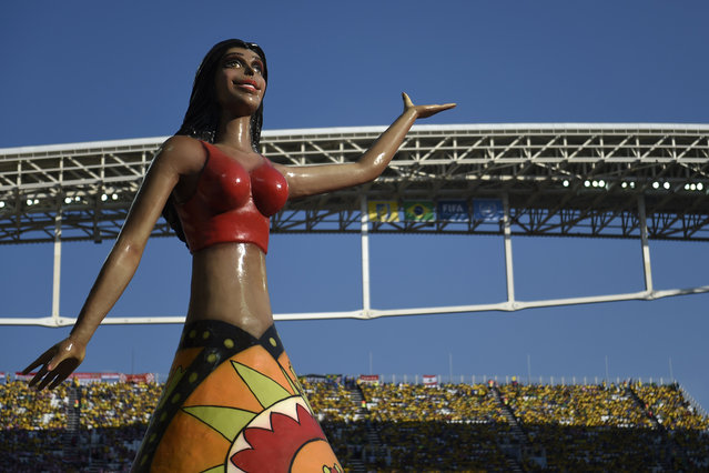 A statue is seen during the opening ceremony of the 2014 FIFA football World Cup at the Corinthians Arena in Sao Paulo on June 12, 2014. (Photo by Odd Andersen/AFP Photo)