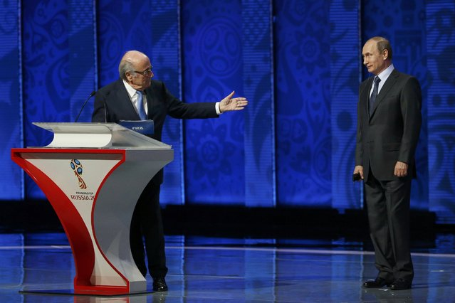 FIFA's President Sepp Blatter (L) invites Russia's President Vladimir Putin to address during the preliminary draw for the 2018 FIFA World Cup at Konstantin Palace in St. Petersburg, Russia July 25, 2015. (Photo by Grigory Dukor/Reuters)