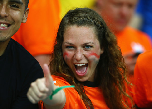 A fan of the Netherlands celebrates after defeating Spain 5-1 during the 2014 FIFA World Cup Brazil Group B match between Spain and Netherlands at Arena Fonte Nova on June 13, 2014 in Salvador, Brazil. (Photo by Quinn Rooney/Getty Images)
