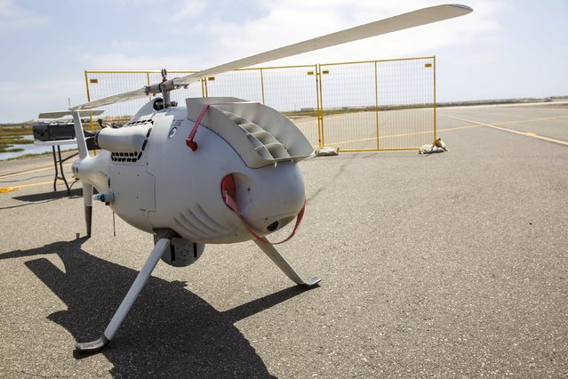 """Boeing Co. & Schiebel Industries' S-100 Camcopter stands on the runway during """"Black Dart"""", a live-fly, live fire demonstration of 55 unmanned aerial vehicles, or drones, at Naval Base Ventura County Sea Range, Point Mugu, near Oxnard, California July 31, 2015. (Photo by Patrick T. Fallon/Reuters)"""