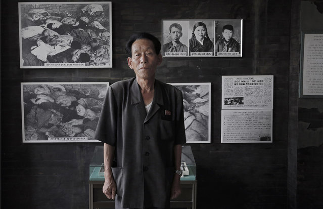 In this June 24, 2015, photo, Jong Kun Song, 70, a guide at the Sinchon Museum of American War Atrocities, poses for a portrait in front of an old photograph of himself as a child on display, in South Hwanghae, North Korea. (Photo by Wong Maye-E/AP Photo)