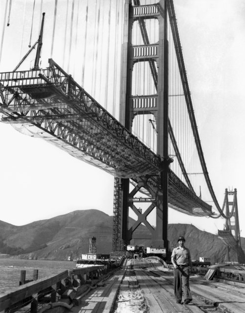 A workman walks on the levee that connects Fort Point to the south tower of the Golden Gate Bridge while it is under construction, San Francisco, California, October 1936. (Photo by Underwood Archives/Getty Images)
