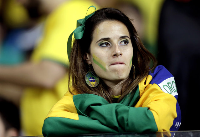 A Brazil supporter watches after Germany scored five goals in the first half during the World Cup semifinal soccer match between Brazil and Germany at the Mineirao Stadium in Belo Horizonte, Brazil, Tuesday, July 8, 2014. (Photo by Natacha Pisarenko/AP Photo)