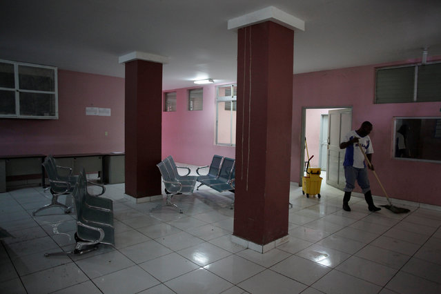 A worker cleans the floor of an empty waiting room at The Peace (La Paix) Hospital, which is one of the centers affected by a three-month-long strike by health workers demanding a pay rise and resources, in Port-au-Prince, Haiti, June 22, 2016. (Photo by Andres Martinez Casares/Reuters)