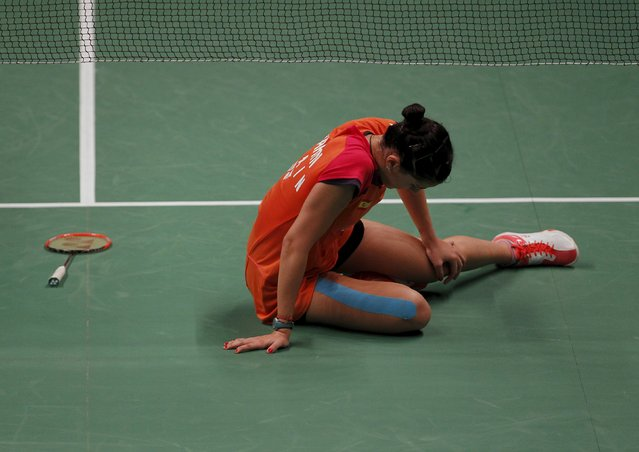 Spain's Carolina Marin reacts after injuring her foot during her women's singles badminton match with Taiwan's Pai Yu-po at the BWF World Championship in Jakarta, Indonesia August 13, 2015. (Photo by Nyimas Laula/Reuters)