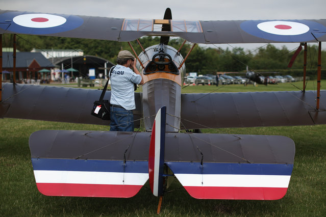 """An aviation enthusiast takes a photograph of  Sopwith Pup at """"The Shuttlesworth Collection"""" on July 21, 2014 in Biggleswade, England. Of the 55,000 planes that were manufactured by the Royal Army Corps (RAC) during WWI, only around 20 remain in airworthy condition. (Photo by Dan Kitwood/Getty Images)"""