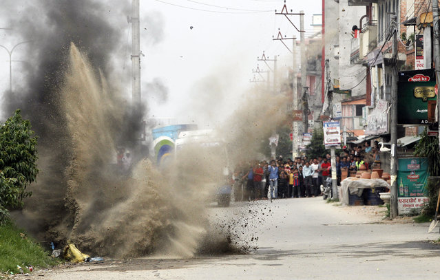 Nepalese Army's bomb disposal team detonate the explosives during the local election in Bhaktapur, Nepal, Sunday, May 14, 2017. Two explosive devices were planted across from a candidate's house. Nepalese were voting Sunday for representatives in municipal and village councils for the first time in two decades, a sign that the country's fractious democracy may be stabilizing. (Photo by Niranjan Shrestha/AP Photo)