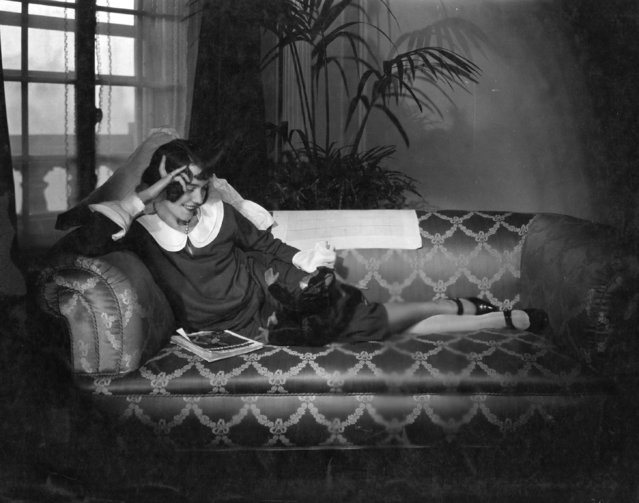 Actress Adele Astaire (1898–1981) relaxing with her toy monkey, 1926