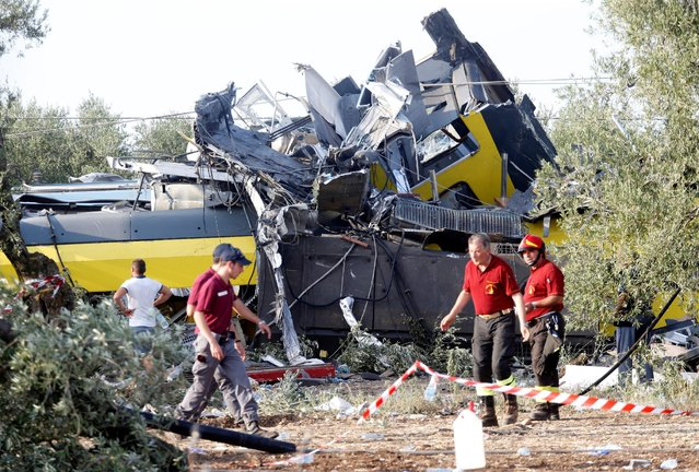 Rescuers work at the site where two passenger trains collided in the middle of an olive grove in the southern village of Corato, near Bari, Italy, July 12, 2016. (Photo by Alessandro Garofalo/Reuters)