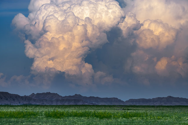 Storm towers erupt over the badlands of South Dakota June 18, 2008. (Photo by Mike Hollingshead)