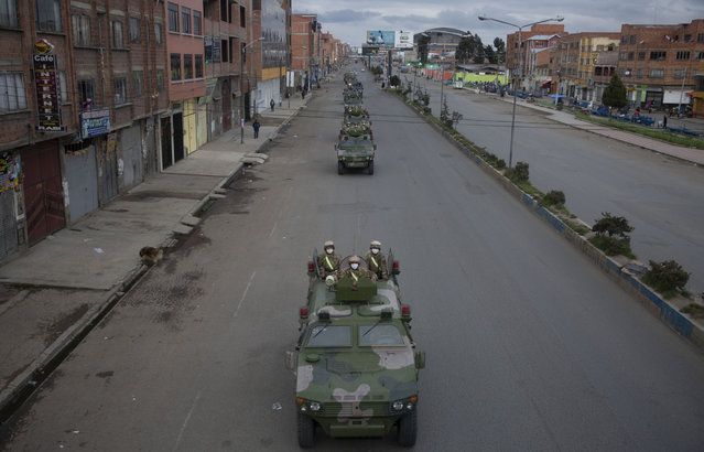 Military armored vehicles patrol the streets during a quarantine in El Alto, Bolivia, Friday, March 20, 2020. Authorities have decreed a quarantine from 5pm to 5am in an attempt to stop the spread of the new coronavirus. The vast majority of people recover from the COVID-19 disease. (Photo by Juan Karita/AP Photo)
