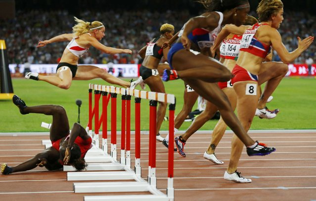 Dawn Harper Nelson of U.S. crashes into a hurdle in the women's 100 metres hurdles semi-final during the 15th IAAF World Championships at the National Stadium in Beijing, China August 28, 2015. (Photo by Damir Sagolj/Reuters)