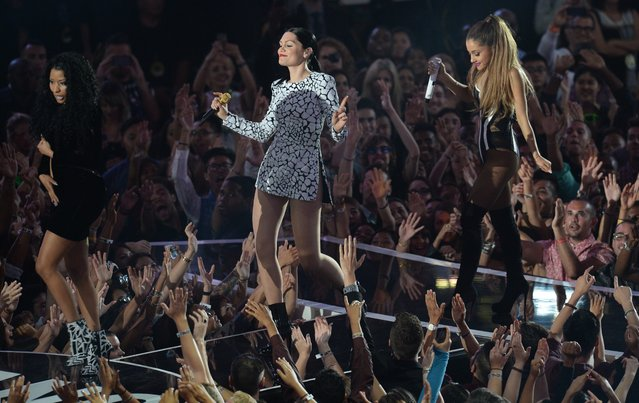 Jessie J. (C) performs on stage with Nicki Minaj (L) and Ariana Grande at the MTV Video Music Awards (VMA), August 24, 2014 at The Forum in Inglewood, California. (Photo by Robyn Beck/AFP Photo)