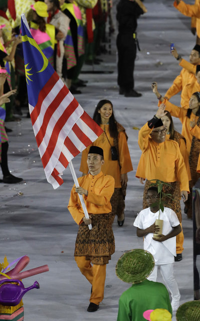 Chong Wei Lee carries the flag of Malaysia during the opening ceremony for the 2016 Summer Olympics in Rio de Janeiro, Brazil, Friday, August 5, 2016. (Photo by Matt Slocum/AP Photo)