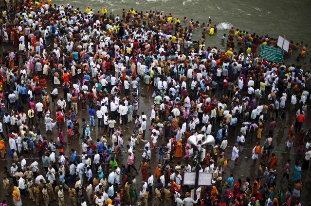 "Devotees attend the second ""Shahi Snan"" (grand bath) on the banks of Godavari river at the ongoing Kumbh Mela or Pitcher Festival in Nashik, India, September 13, 2015. (Photo by Adnan Abidi/Reuters)"