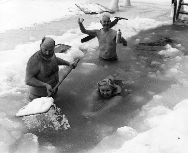 People swimming in a frozen lake in Scandinavia, February 1972. (Photo by Fox Photos)
