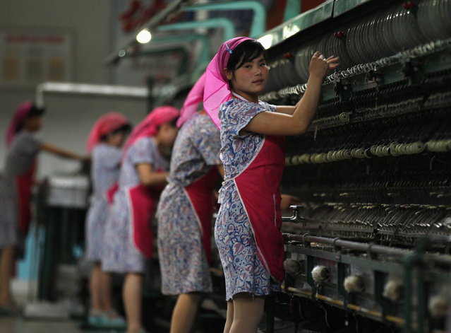 Women work in the Kim Jong-suk Pyongyang Silk Mill in Pyongyang, April 9, 2012. The factory is named after the wife of North Korea founder Kim Il-sung. (Photo by Bobby Yip/Reuters)