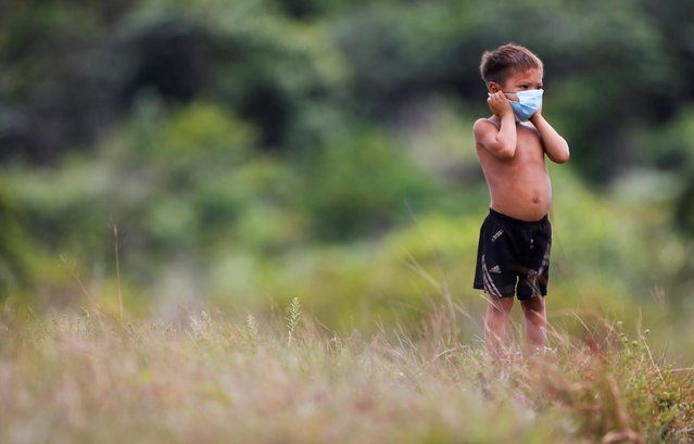 An Indigenous child from Yanomami ethnic group is seen, amid the spread of the coronavirus disease (COVID-19), at the 4th Surucucu Special Frontier Platoon of the Brazilian army in the municipality of Alto Alegre, state of Roraima, Brazil on July 1, 2020. (Photo by Adriano Machado/Reuters)
