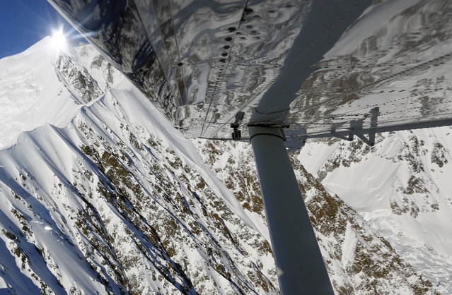 Snow-covered mountains are seen during a flight over the Kluane National Park and Reserve in southwestern Yukon Territory, October 7, 2014. (Photo by Bob Strong/Reuters)