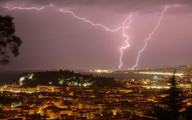 A picture taken on October 23, 2019 shows lightning flashing through the sky over the French riviera city of Nice, southeastern France. (Photo by Valery Hache/AFP Photo)