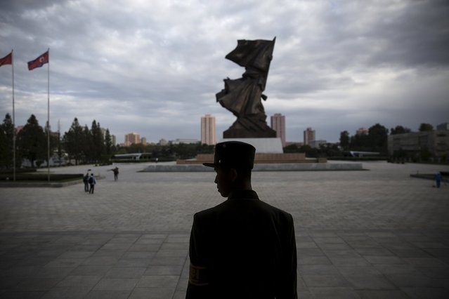 A soldier stands guard at the doors of the War Museum visited by foreign reporters during a government organised tour in Pyongyang, North Korea October 9, 2015. (Photo by Damir Sagolj/Reuters)