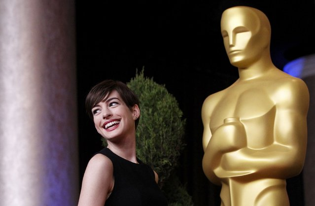 """Actress Anne Hathaway, nominated for best supporting actress for her role in """"Les Miserables"""", poses at the 85th Academy Awards nominees luncheon in Beverly Hills, California February 4, 2013. (Photo by Mario Anzuoni/Reuters)"""