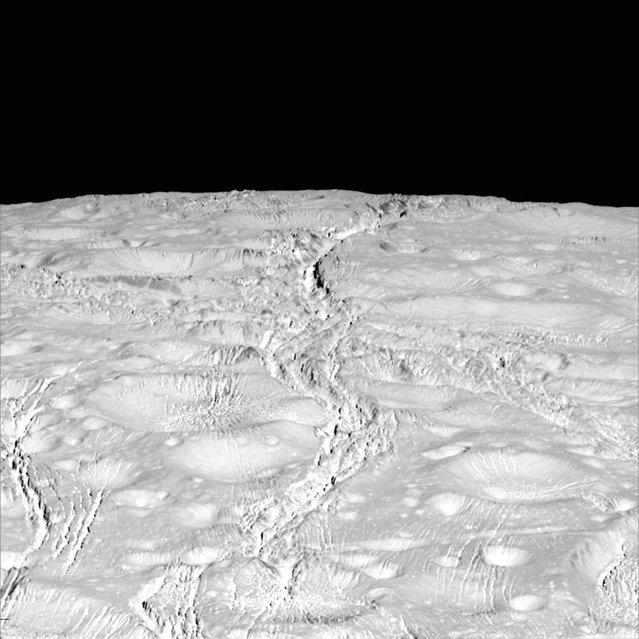 The north pole of Saturn's icy moon Enceladus is seen in an image from NASA's Cassini spacecraft taken October 14, 2015. The moon's north pole lies approximately at the top of this view from Cassini's wide-angle camera. The view was acquired at a distance of approximately 4,000 miles (6,000 kilometers) from Enceladus. (Photo by Reuters/NASA/JPL-Caltech/Space Science Institute)