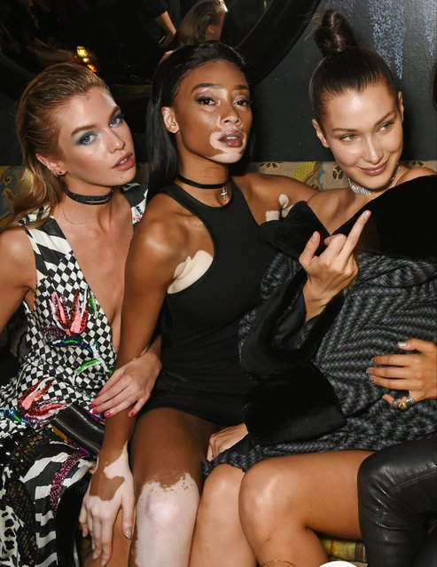 (L to R) Stella Maxwell, Winnie Harlow and Bella Hadid attend the LOVE Magazine and Marc Jacobs LFW Party to celebrate LOVE 16.5 collector's issue of LOVE and Berlin 1989 at Loulou's on September 19, 2016 in London, England. (Photo by David M. Benett/Dave Benett/Getty Images for LOVE/CONDE NAST)