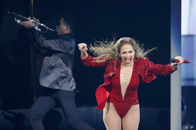 """Jennifer Lopez performs """"Booty"""" during the 42nd American Music Awards in Los Angeles, California November 23, 2014. (Photo by Mario Anzuoni/Reuters)"""