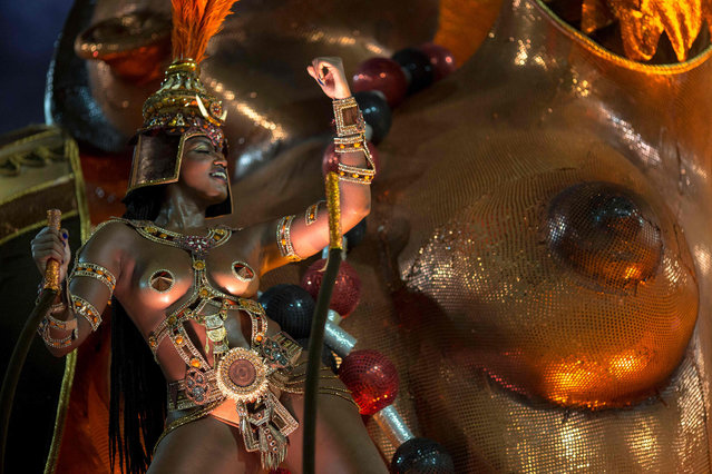 A reveller of the Salgueiro samba school performs during the second night of Rio's Carnival at the Sambadrome in Rio de Janeiro, Brazil, on February 13, 2018. (Photo by Mauro Pimentel/AFP Photo)