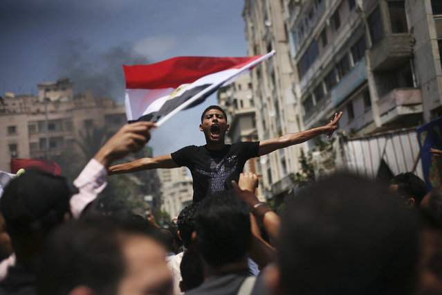 An Egyptian protester chants slogans against presidential candidate Ahmed Safiq during a demonstration against the Supreme Constitutional Court rulings in Alexandria, Egypt, June 15, 2012. (Photo by Manu Brabo/AP Photo)