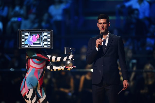 Tennis pro Novak Djokovic presents best Hip-Hop award on stage during the MTV EMA's 2015 at the Mediolanum Forum on October 25, 2015 in Milan, Italy. (Photo by Brian Rasic/Getty Images for MTV)