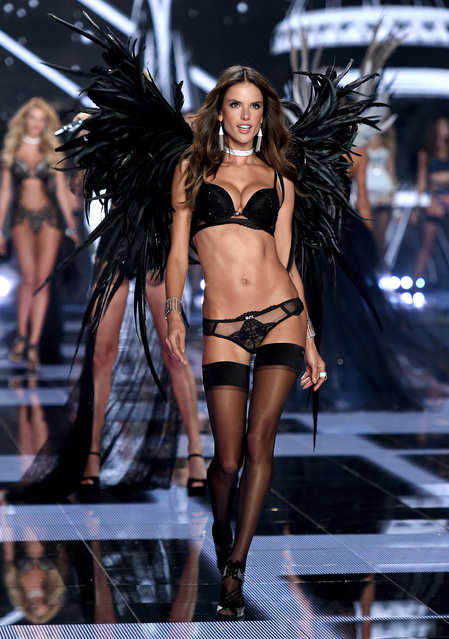Model  Alessandra Ambrosio  walks the runway during the 2014 Victoria's Secret Fashion Show at Earl's Court Exhibition Centre on December 2, 2014 in London, England. (Photo by Dimitrios Kambouris/Getty Images for Victoria's Secret)