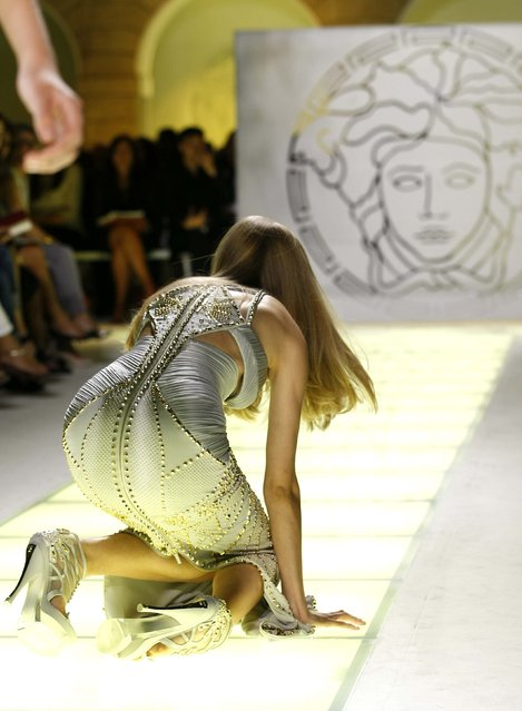 A model falls as she displays a creation as part of Versace Spring/Summer 2012 women's collection during Milan Fashion Week September 23, 2011. (Photo by Alessandro Garofalo/Reuters)